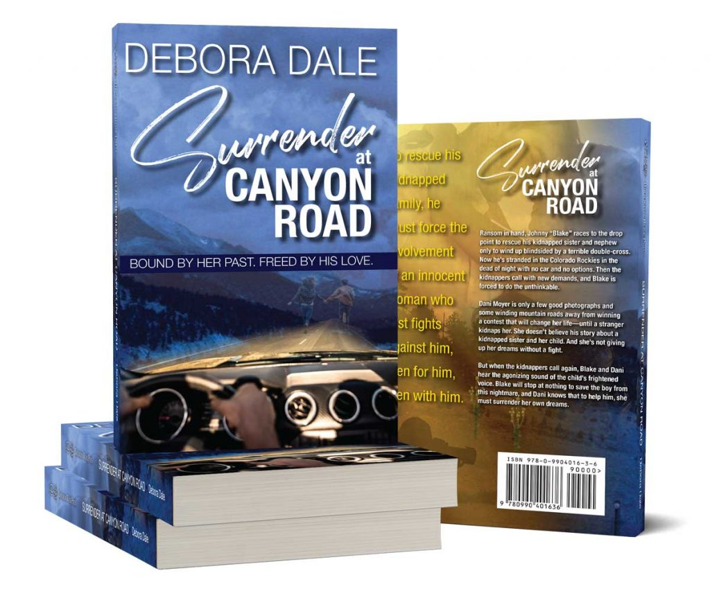 Product shots of Surrender at Canyon Road, a romantic suspense novel by Debora Dale